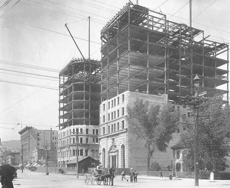 [p.336] 329. The Boston and Newhouse buildings on Main Street climb toward the sky on 30 June 1908.