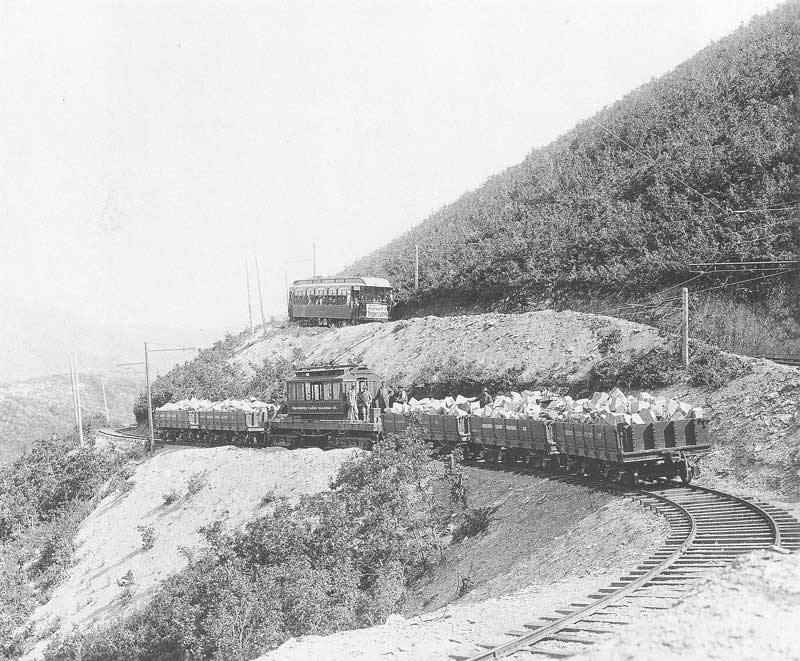 [p.341] 334. An engine pushes and pulls carloads of white sandstone down Emigration Canyon in 1907. The railroad was built that year to transport stones from mountain quarries east of Salt Lake City for construction projects in the city. On the upper track is the Emigration Railway engine Wanship taking tourists to Point Lookout for a popular view of the valley.