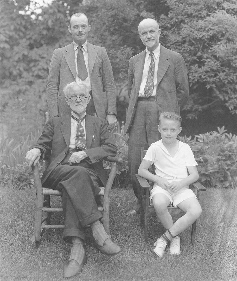 [p.348] 341. Four generations of Shiplers in the backyard of the Shipler home on Elizabeth Street in 1937 or 1938. Seated (left) is James W., and standing (right) is Harry. On the left is Harry's son, George William. Seated on the right is William Hollis Shipler, who carries on the family photographic business to this day.