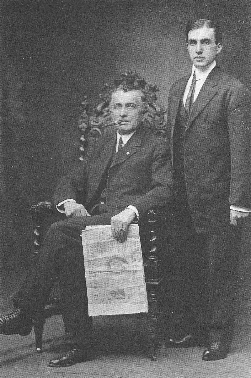 349. The two key players in the sensational story in a New York gallery after the story broke in the Salt Lake Tribune. Florence (seated) is holding a copy of the Tribune. Standing is Gisbert Bossard, a young Swiss convert who had fallen away from Mormonism. He is the photographer who actually took the pictures.