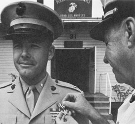 """""""It was a badly wounded marine, a radioman, calling for help. The battalion commander personally came up on the radio, … 'Now son, hold on; we're coming to get you. Where are you?' A faint reply, 'I don't know. I'm all alone.'"""" Howard A. Christy (on left)"""