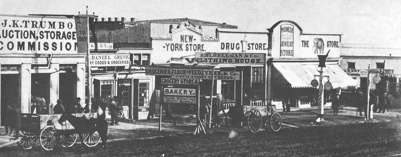 49. Trumbo's Auction House, the New York Store, and the Elephant Store are pictured on East Temple Street sometime around 1868. Utah commerce was beginning to develop in the mid-1860s as businessmen sought to develop the territory's mineral resources, which proved to be the center of contention in the Mormon economy.