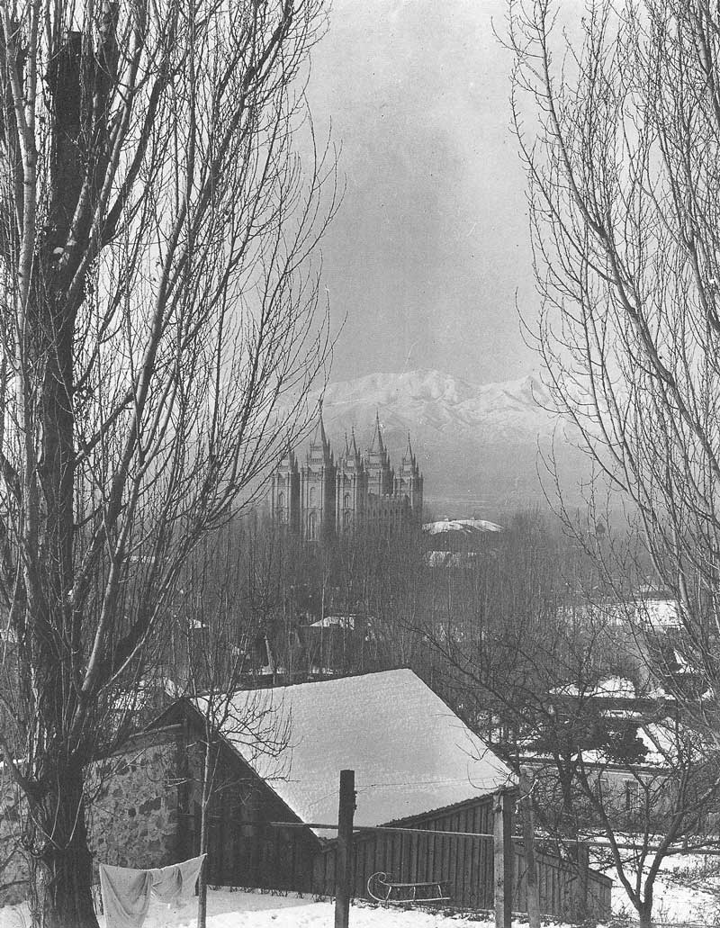 [p.375] 366. The sun glints off the Salt Lake temple in 1912 when photographed by Heber Thomas on a cold winter day after the city has been covered with a light dusting of snow.