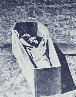 John D. Lee in his coffin