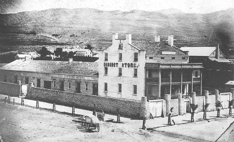 53. The Deseret Store and the General Tithing Office are pictured in this Marsena Cannon view taken in 1861 from the top of the Council House, looking toward the northeast. The Deseret News offices were located on the second floor. This view was also in the Barfoot photographic exhibit.