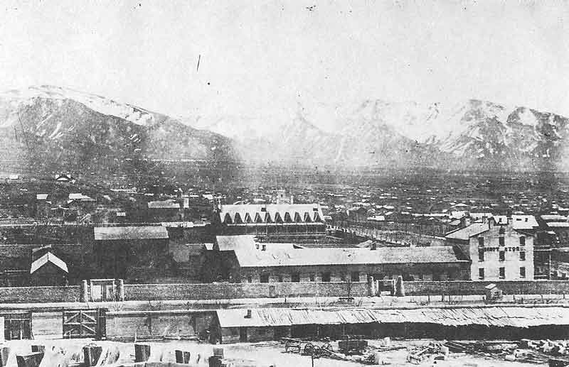 60. In the foreground, one can see portions of the temple foundation. These rare pictures were enlarged from faded cartes-de-visites in the photographic collection of the Daughters of the Utah Pioneers Museum.
