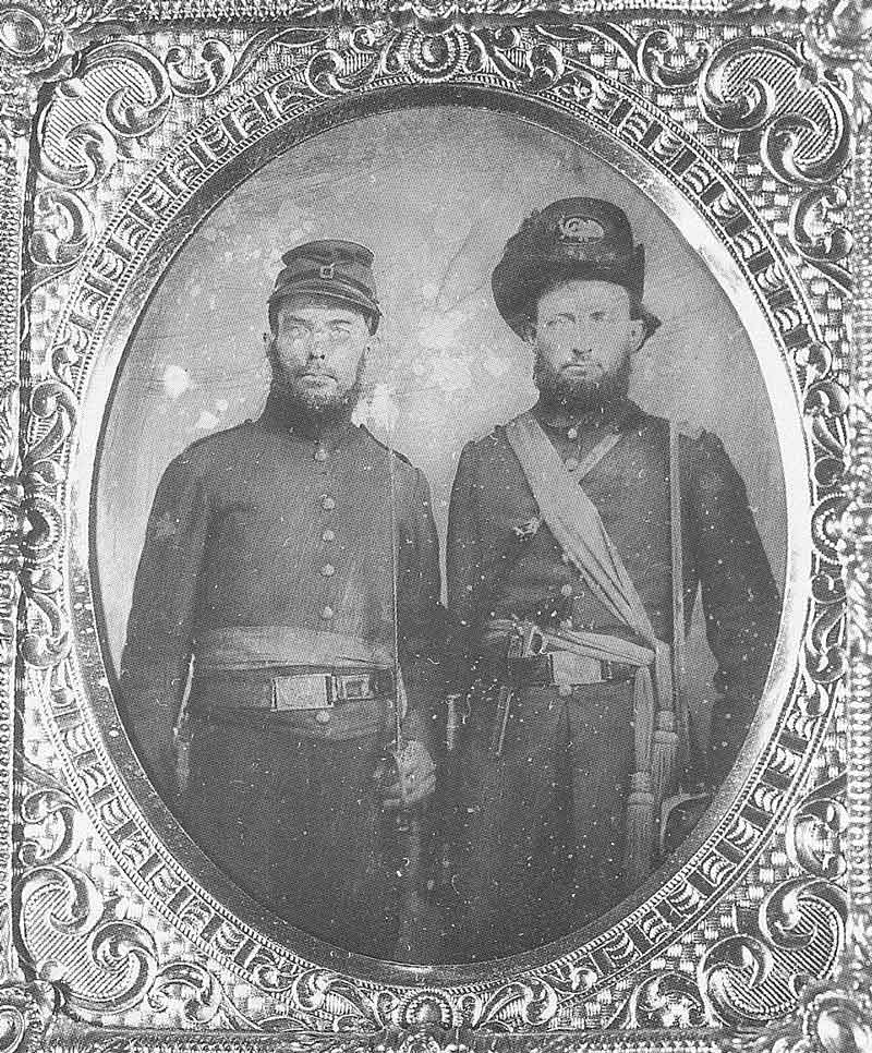 61. Captain Nathaniel Crain, right, and an unknown man are pictured in their Nauvoo Legion uniforms sometime in the 1860s. This original tintype is in the Daughters of the Utah Pioneers Museum.