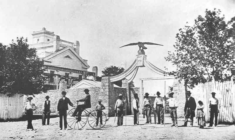 [p.53] 62. A group of Salt Lake City residents in front of the Eagle Gate entrance to the estate of Brigham Young. The wooden tin-covered eagle was built around 1860 and stood as a sentinel to the extensive property of the Mormon prophet.