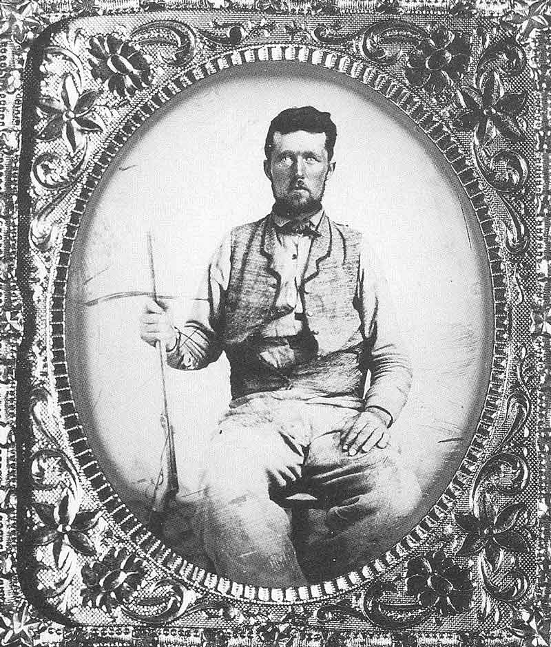 68. An unidentified man poses with his favorite rifle in a Salt Lake gallery sometime in the 1860s. The original tintype is in the Daughters of the Utah Pioneers Museum.
