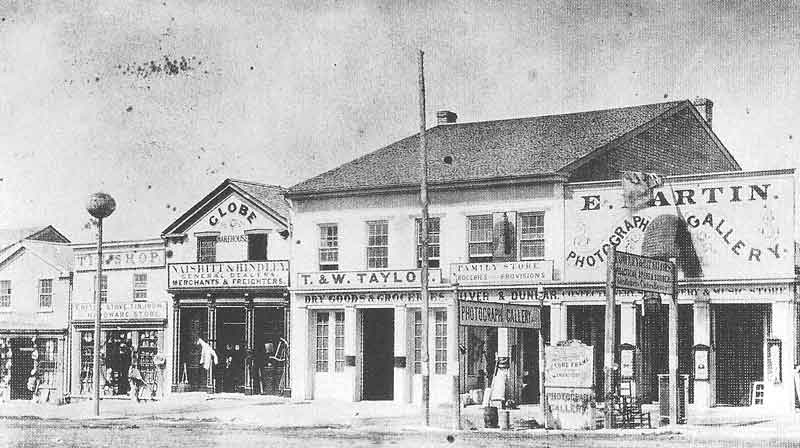 69. The Martin gallery was located on the west side of East Temple Street, between First and Second South. This picture was taken sometime in the 1860s when the business was thriving.