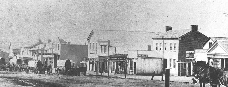 71. Wagons are parked on the west side of East Temple Street in this early view of Great Salt Lake City, ca. 1860.