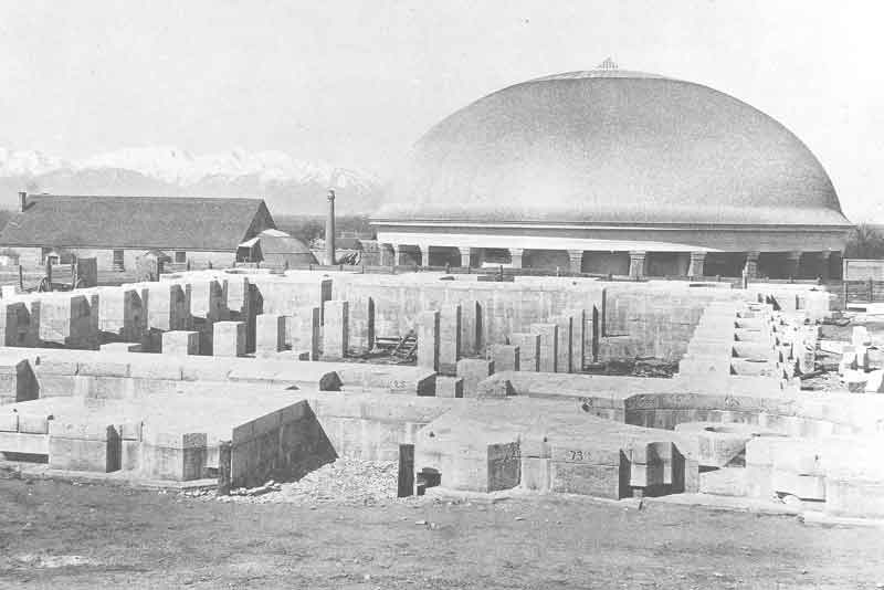 [p.63] 74. Granite stones begin to rise from ground level in this view of Temple Square around 1870. In the background, the Old Tabernacle and the new one stand side by side. Eventually, the old meeting place would be torn down to make for the Assembly Hall.