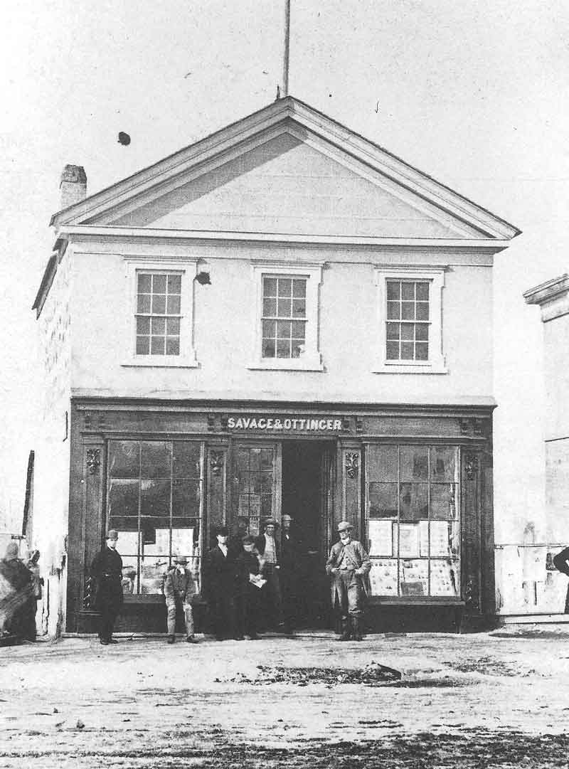 [p.73] 82. The second Savage & Ottinger gallery was located on the west side of East Temple Street, just south of the Council House. This picture shows how the establishment looked at the peak of its business in the mid-1860s.