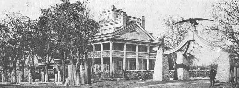 86. By the 1870s, Brigham Young's residence was landscaped and the gate had been removed from beneath the outstretched wings of the eagle.