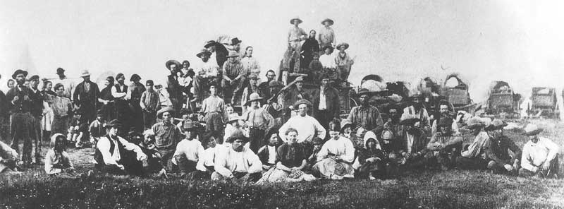 89. Members of the 1866 wagon train pose for their portrait on their way to Utah. Savage had difficulty making pictures on the trek because of native American attacks and an accident in the Platte River where he lost a portion of his new supplies.