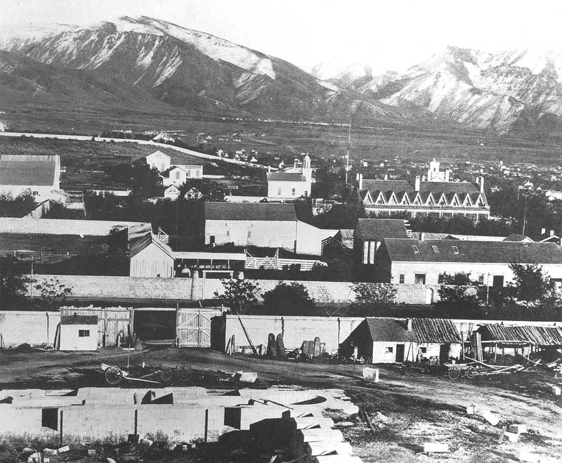 [p.82] 92. The temple foundation is just beginning to rise in this 1869 view taken by Andrew Joseph Russell, an eastern photographer who visited Salt Lake City that year while photographing construction of the railroad.