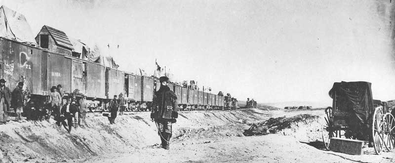 93. Civil War general John S. Casement stands in front of the Irish track-laying force near Promontory, Utah, in 1869. The construction crew was commanded like a Union Army unit. To the right is Andrew Joseph Russell's wet-plate field darkroom wagon.