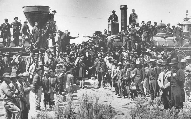 "[p.84] 94. Russell's view of ""East shaking hands with West"" at Promontory Summit, Utah, is among the most famous news photos of the nineteenth century. This decisive moment was captured moments after the golden spike was driven and the engines of the two railroads moved together. In the center, Union Pacific's Grenville M. Dodge shakes hands with Central Pacific's chief engineer, Samuel S. Montague. Savage's photograph of the same moment, which was similar to Russell's, was published as a woodcut in Harper's Weekly but the original negative was destroyed in a fire in 1883."