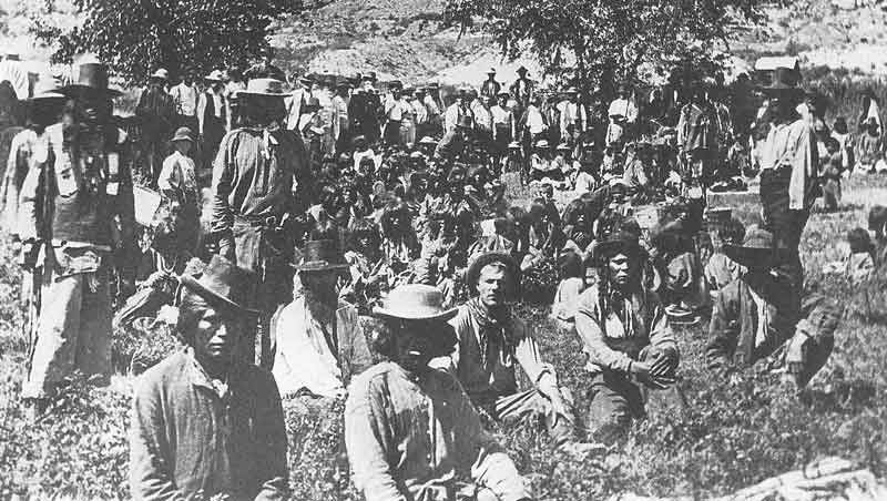 The second shows Powell (standing on the right) with the Paiutes in a pow-wow near the Colorado River in 1872.