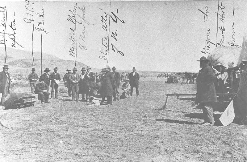 [p.88] 99. John D. Lee, convicted of complicity in the Mountain Meadows massacre, sits on the edge of his coffin shortly before he is to be shot to death by a federal firing squad. James Fennemore, who took this picture, was the only known photographer at the execution. The crudely scribbed identifications are probably by Fennemore or someone else who was there.