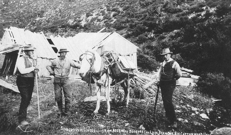 101. Ottinger, left, and Savage, right, rest with their pack mule and an unidentified friend shortly after an ascent to Lake Blanche in Big Cottonwood Canyon.