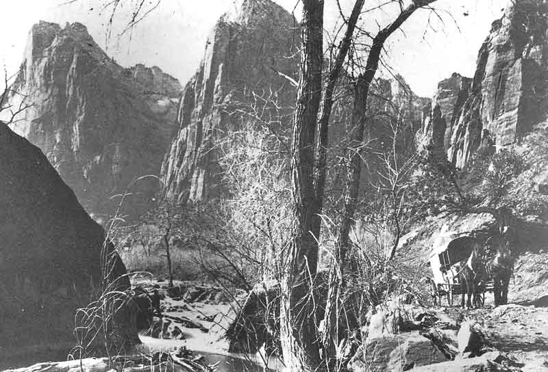 104. Savage's wagon makes its way over a rough trail in this early view of Little Zion along the Virgin River. If this picture were taken on his 1870 southern Utah trip, it would be among the first known pictures of the future national park.