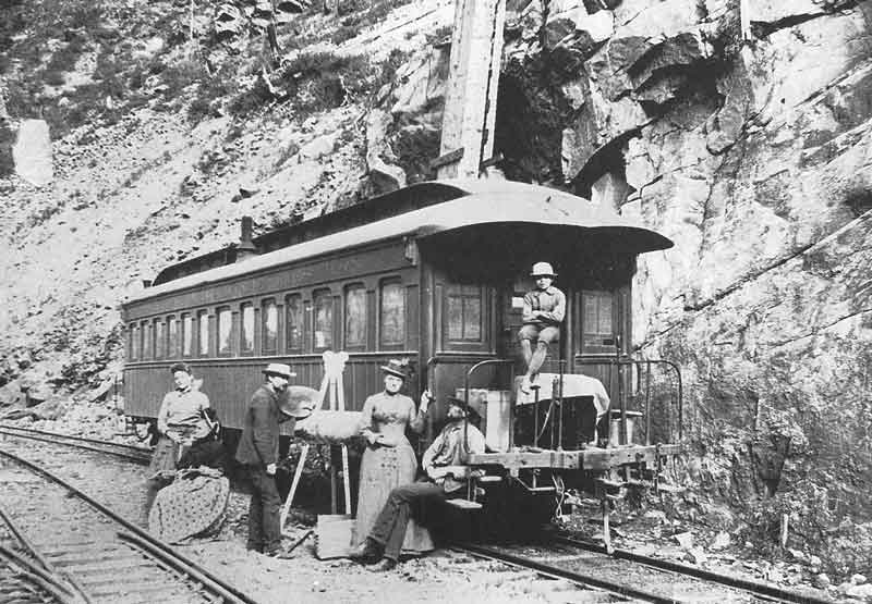 106. Members of Savage's family and artist Alfred Lambourne enjoy a private car provided by Denver & Rio Grande Western Railroad. Both D&RG and Union Pacific gave Savage access to private cars as well as free passes over their lines. They were anxious to have him photograph scenery along their routes.