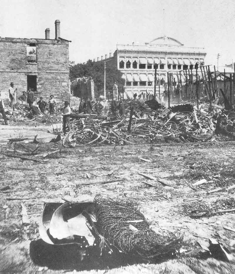 [p.97] 108. Only rubble remains of Savage's gallery after an explosion and fire leveled the building in 1883. The photographer's entire negative collection was destroyed. This view looks east toward Zion's Cooperative Mercantile Institution on East Temple Street.