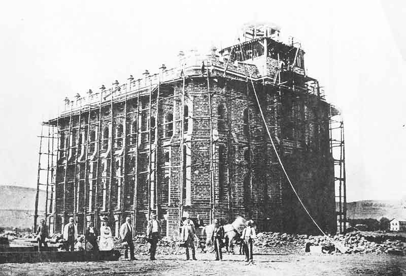 110. Plasterers begin to apply the outer finish to the exterior of the St. George temple in the mid-1870s when it was photographed by Savage. The St. George temple was the first temple completed in Utah.