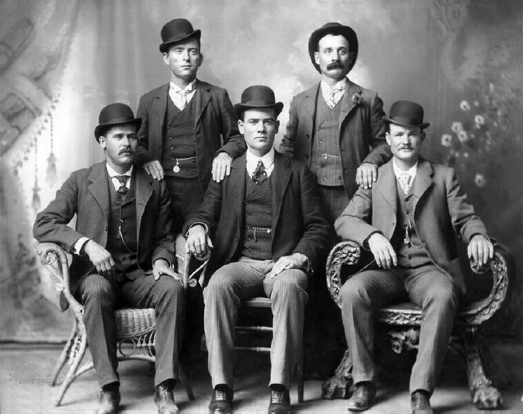 The Wild Bunch at Ft. Worth, Texas. Sitting, L-R: Harry Longbaugh, Ben Kilpatrick, Butch Cassidy, Standing, L-R: Bill Carver, Harvey Logan. Photograph by John Schwartz, winter 1900-01, courtesy Union Pacific Railroad.